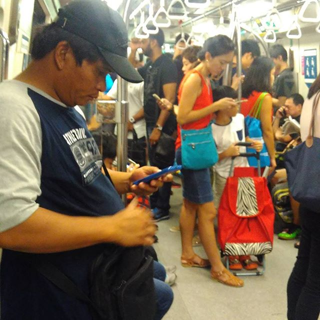 Back to the multi-racial, pole-leaning, everyone looking at phone, train-riding Singapore. :D